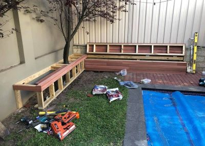 Before picture of a custom built timber outdoor pool seating area